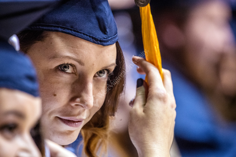 Maren Prediger, receiving a masters in Chemistry as well as a member of the Rifle Team moves her tassle from right to left during the conferral of degrees at the Eberly College of Arts and Sciences and the College of Business and Economics December Commencement in the Coliseum December 15th, 2017.  Photo Brian Persinger