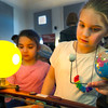 Natalie Esposito (right) and her sister, Elizabeth tinker with a solar model that shows how the moon crosses between the Earth and Sun to cause elcipses at the Physics booth in the When I Gorw Up... event Wednesday, March 29, 2017 in the Museum Education Center. When I Grow Up... is an event to show young girls some of the different paths available fo rthem to pursue as they grow older.