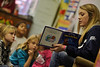 27232x41<br /> <br /> ORIGINAL: December 2010 - Student-athlete Whitney Lee, a member of the WVU volleyball team, reads a book to Suncrest Elementary students as part of Dr. Carolyn Atkins' Speaking to Communities class.