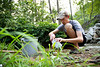 ORIGINAL - Eric Merriam, wildlife and fisheries Ph.D. student, collects water samples