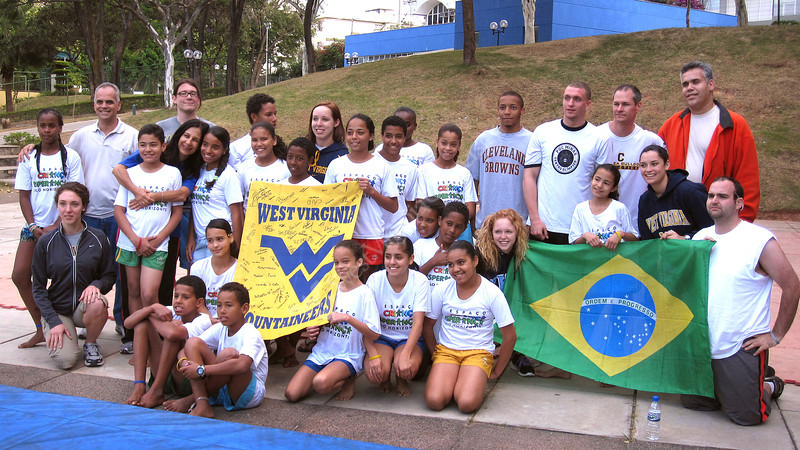 ORIGINAL - WVU students from the College of Physical Activity and Sports Sciences with the gymnasts from Children's Hope, a program developed by PUC Minas University that brings youth from the Favelas (slums) to the university to participate in basketball, track and field, and gymnastics. (Photo courtesy of CPASS.)