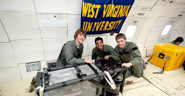 "BUCKET: 7/21/11, Mechanical and Aerospace Engineering students Mark James, Sunny Narayanan, and Byron Patterson pose with their experiment on NASA's ""Weightless Wonder"" aircraft. Submitted photo (others available from WVUToday press release). Photographer: James Blair, Date: 06-09-11"