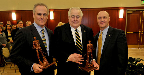 BUCKET: March 15, 2011 - President Jim Clements presents Steve and George Farmer, members of the Hazel Ruby McQuain Charitable Trust, with Mountaineer statues in honor of the Trust's $4.6 million gift for graduate fellowships. The gift will be matched by the state's Research Trust Fund to create a nearly $10 million endowment.
