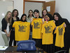 ORIGINAL: June 28, 2010 — Students at Bahrain's Royal University for Women accept gold t-shirts from WVU students visiting as part of an exchange coordinated by Leadership Studies Program director Lisa DeFrank-Cole. Later this summer, these RUW students will spend three weeks in Morgantown taking Leadership 201 during WVU's Honors Leadership Academy.