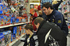 27285_0040<br /> <br /> ORIGINAL: December 2010 - Lacrosse club team member with children participating in the SHOP (Students Helping Other People) program