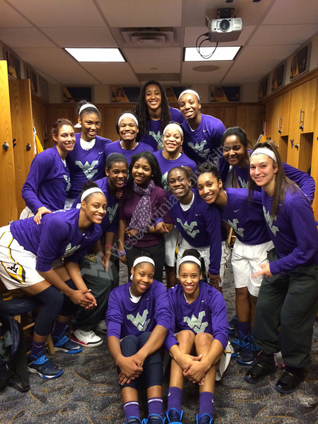 Submitted by Athletics - Women's basketball team with manager SeLarra Armstrong