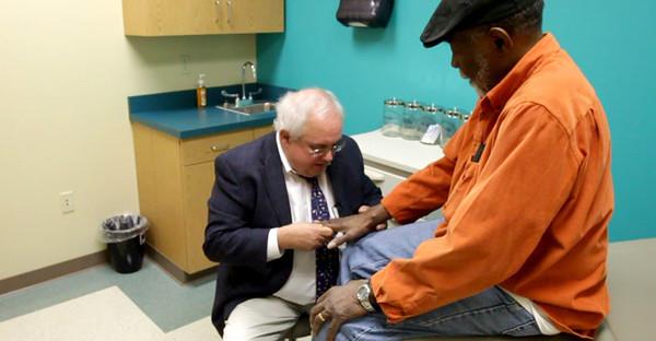 BUCKET - Dr. Brick at Gilbert Clinic (still from video)