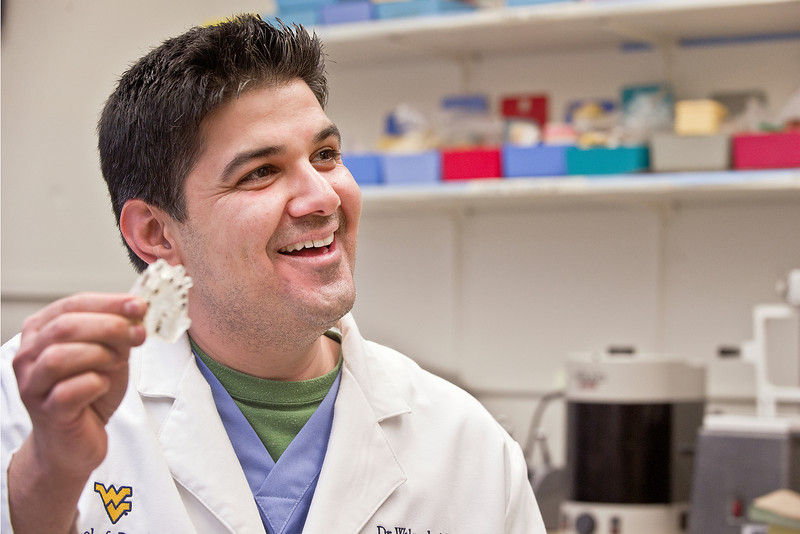 27431a0084xx ORIGINAL - Dental resident Dr. Waleed Alyassin plans to use the skills he acquired in WVU's first-ever Preceptorship Program in Periodontics and Dental Implants to change lives in his home country of Kuwait. He hopes it's the beginning of an ongoing relationship between School of Dentistry faculty and dentists in Kuwait.