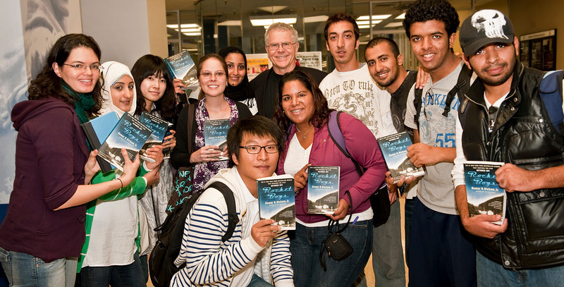 "26384A0052xx bucket<br /> <br /> Nov. 11, 2009 — Intensive English Program students meet best-selling author Homer Hickam during his visit to campus. Hickam, who was born in Coalwood, W.Va., is best known for his memoir, ""Rocket Boys."" While at WVU, he signed books and offered advice to aspiring writers in Dr. Mark Brazaitis' English graduate fiction workshop."