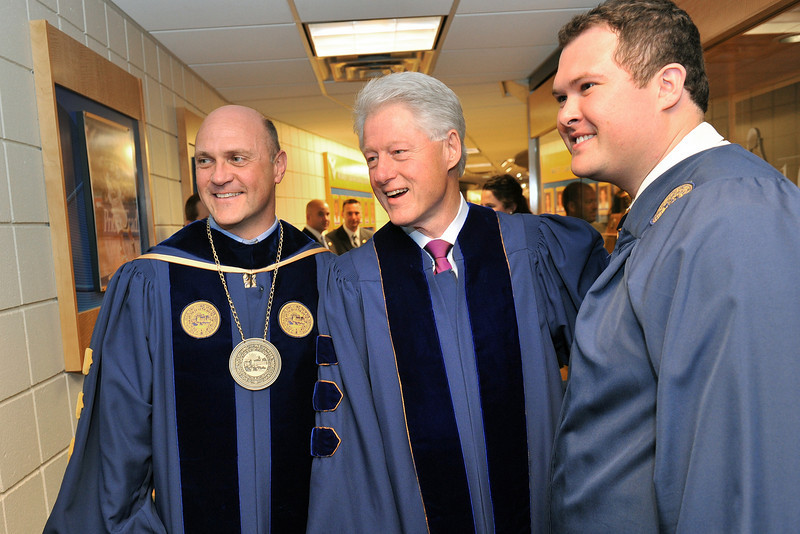 "ORIGINAL - Former President Bill Clinton greets WVU President James Clements and political science senior Jason Parsons, who invited Clinton to speak at the Eberly College Commencement. Clinton encouraged graduates to volunteer in their communities, reminding them that ""we are in this future together."""
