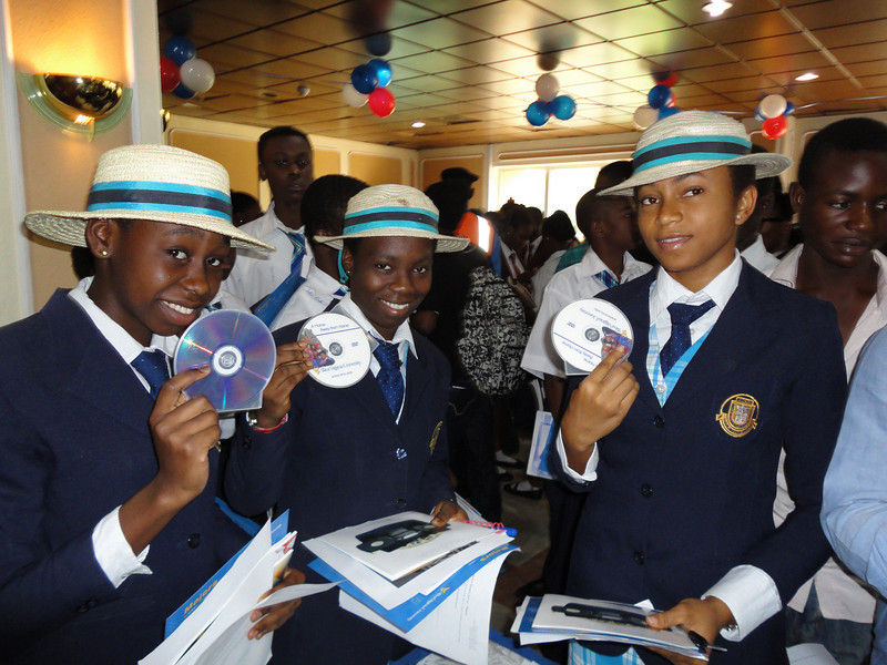 ORIGINAL: Regina Pacis Girls Secondary School students learn about WVU at a college fair in Abuja, Nigeria. After stops in Nigeria, Ghana, and South Africa, WVU representatives joined about 20 other universities for a two-week recruiting tour of the African continent. (fall 2010)