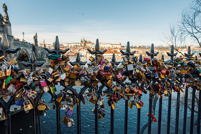 Lots of love locks attached to railings near to Charles Bridge