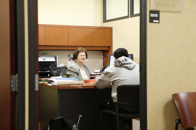On Campus Jobs Manager MaryAlice Dunn talks with WVU student Michael Sierra about job openings. They are in the new Office of Student Employment in the basement of the Mountainlair at WVU.