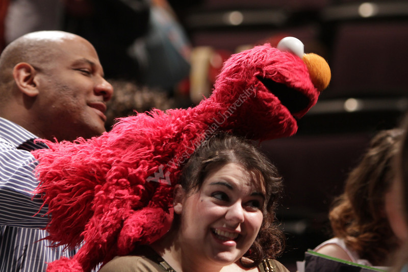 Elmo poses for pictures with WVU students. Kevin Clash, the master puppeteer behind Elmo, visits WVU to talk to students in the puppetry program. Later in the day he presented the annual Dan and Betsy Brown Lecture at the Met Theater.4/15/2011 Photo by Scott Lituchy/WVU