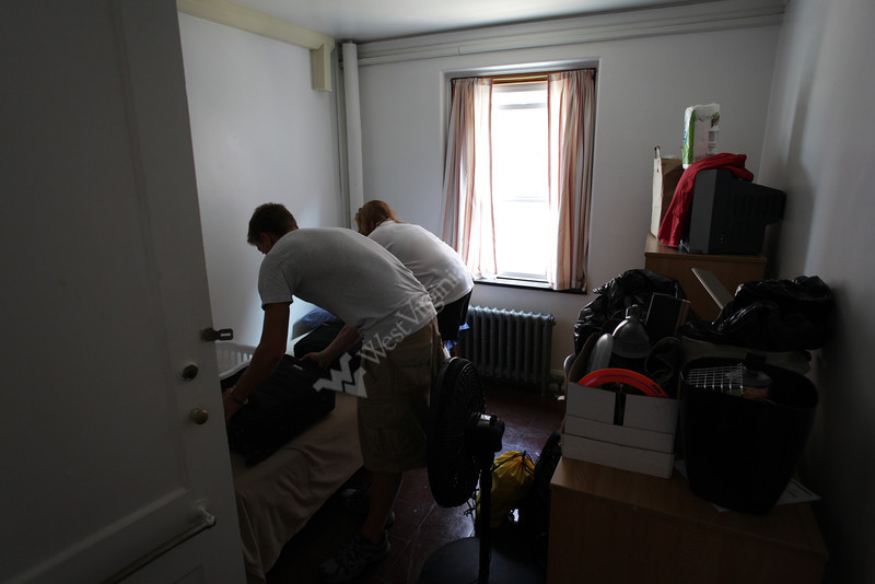 New freshman Josh Kudrna moves into Boreman Hall with the help of his parents Paul and Jan. They are from Cleveland.