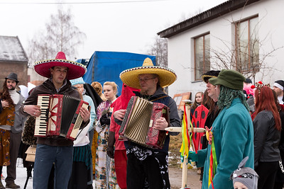 People attend the Masopust Carnival