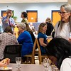 Employees attend WVU Libraries New Faculty Reception at the Evansdale Library on Aug. 15, 2019. Photo taken by Kallie Nealis.