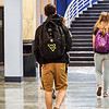 University Police educates students passing through the Mountainlair on pedestrian safety while passing out reflecting Flying WV patches on April 23, 2019. Photo by. Kallie Nealis.