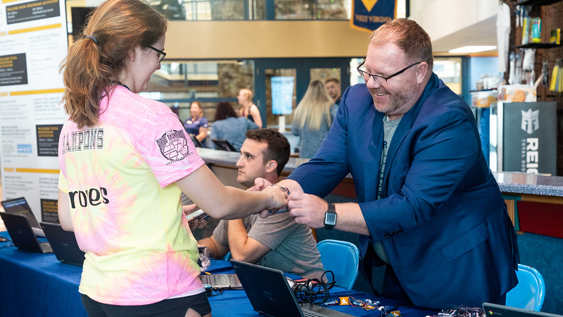 Employees volunteer to assist with wristband activation during Welcome Week on Aug. 16, 2019. Photo by Kallie Nealis.