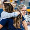 President Gee hugs a student at Monday Night Lights on Aug. 19, 2019. Photo by Kallie Nealis.