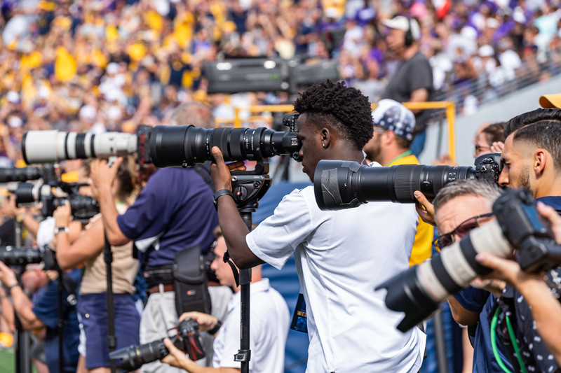 Photographers along the sideline during the matchup against James Madison on Aug. 31, 2019. Photo by Kallie Nealis.