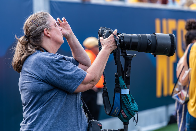 Jenny Shephard capturing action shots during the matchup against James Madison on Aug. 31, 2019. Photo by Kallie Nealis.
