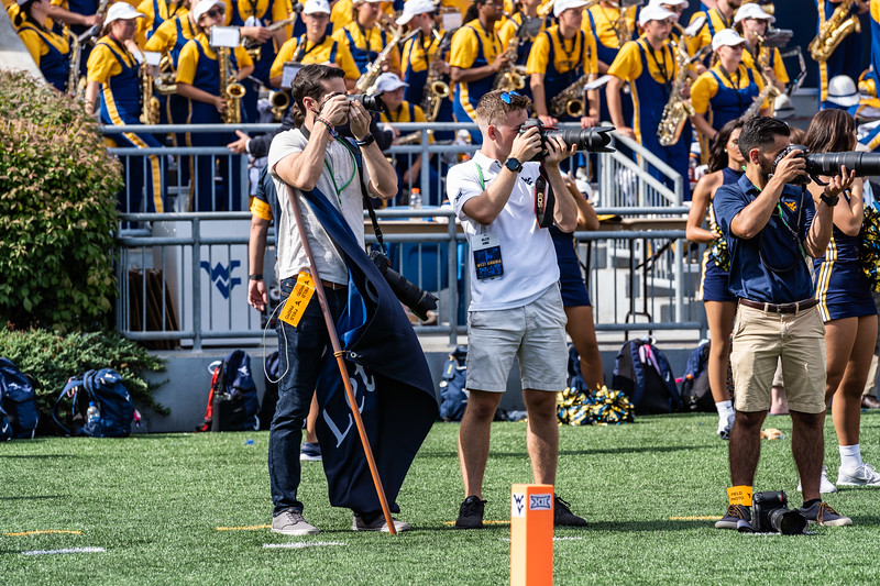 Geoff Coyle and Alex King capturing shots from the sidelines during the matchup against James Madison on Aug. 31, 2019. Photo by Kallie Nealis.