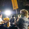 Employee volunteers assisting with t-shirt and pizza distrubtion at Monday Night Lights on Aug. 19, 2019. Photo by Kallie Nealis.