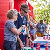 Employee volunteers help at the Coca-Cola beverage tent during Fall Fest on Aug. 20, 2019. Photo by Kallie Nealis.