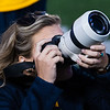 Kallie Nealis, Social Media Specialist , takes a photo of fans at Milan Puskar Stadium on October 5, 2019. (Photo Chris Young)