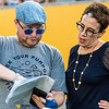 Joel Brown and Maryanne Reed going over the schedule of events at Monday Night Lights on Aug. 19, 2019. Photo by Kallie Nealis.