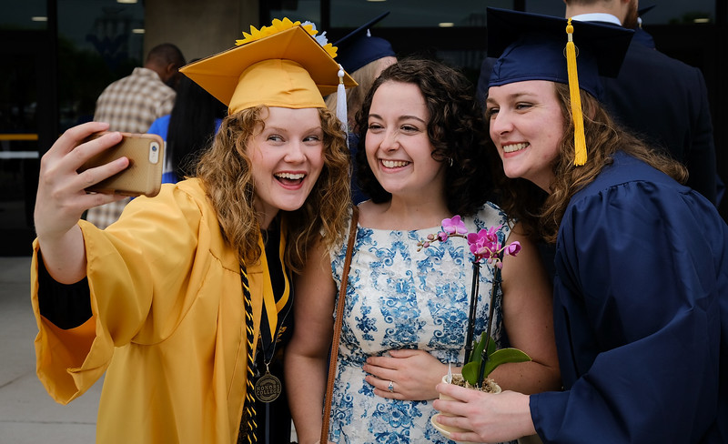 Graduates take a selfie after the end of the Eberly College of Arts and Sciences graduation ceremony on May 12, 2019. (Photo Chris Young)
