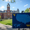 The #WVUgrad map sits outside of Woodburn Hall on May 8, 2019. (Photo Chris Young)