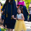 A mother and daughter waiting in line for a graduation photo in Woodburn Circleon May 8, 2019. (Photo Chris Young)