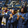 Students clap at the conclusion of Commencement inside the WVU Coliseum, May 10, 2019. Photo: Geoff Coyle
