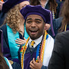 A PhD student smiles outside the Creative Arts Center ahead of the College of Law graduation ceremony on May 10, 2019. (Photo Chris Young)