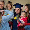 A WVU student poses for a photo with her family following the conclusion of Commencement on Dec. 21, 2019. Photo: Geoff Coyle