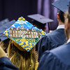 A WVU graduate wears a cap decorated to resemble Martin Hall during a Commencement ceremony, May 10, 2019. Photo: Geoff Coyle