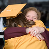 A WVU student gets a hug following Commencement on Dec. 21, 2019. Photo: Geoff Coyle