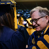 President Gee chats to graduates before the Eberly College of Arts and Sciences graduation ceremony on May 12, 2019. (Photo Chris Young)