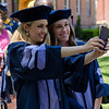 Two PHd students take a selfie in Woodburn Circle on May 8, 2019. (Photo Chris Young)