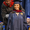 A student is hooded during Commencement, May 10, 2019. Photo: Geoff Coyle
