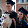 Two graduates pose for a student with their dog outside Woodburn Hall on May 8, 2019. (Photo Chris Young)