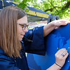 A student puts a pin on a map of the USA to show where she'll go after graduation on May 8, 2019. (Photo Chris Young)