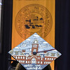 A student wears a cap decorated with an image of Woodburn Hall during Commencement, May 10, 2019. Photo: Geoff Coyle