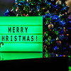 "A green lightboard ""Merry Christmas,"" message, featuring the Mountaineer tamagotchi on Dec. 25, 2019."
