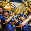 A WVU Pep Band member playing the trombone during a timeout at a women's basketball game on Jan. 15, 2020.  Photo: Kallie Nealis.