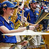 A pep band member playing during a time out of  the men's basketball game facing OK State on Feb. 18, 2020. Photo by Kallie Nealis.