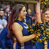 Dance team members cheering on the sidelines during a timeout at the men's basketball game facing OK State on Feb. 18, 2020. Photo by Kallie Nealis.