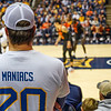 A member of the Mountaineer Maniacs watches the game from the student section at the men's basketball game facing OK State on Feb. 18, 2020. Photo by Kallie Nealis.